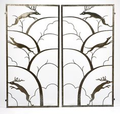 A pair of Art Deco Wrought Iron Gates. Circa 1930, unsigned, each rectangular panel with a stylized design of leaping stags and hounds amongst trees.