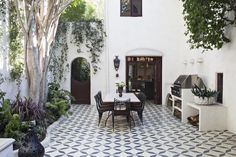 Used in areas where the indoors meets the outdoors, tile can blur boundaries and create unity in a room—it's very Californian, which is very much who we are. In this space, white walls and a lot of white in the tile pattern creates a seamless flow throughout the outdoor room. mariko reed