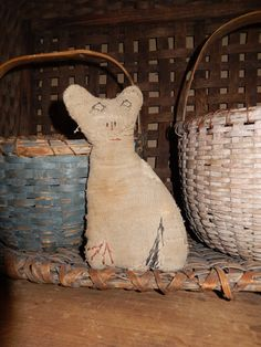 Early cloth cat and baskets