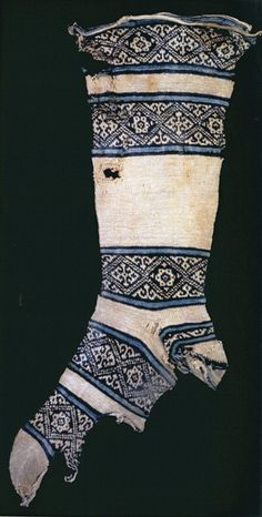 "12th c. cotton white and indigo sock found in Egypt.  From ""Knitting Around the World"""