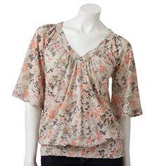 Love this top, great on most shapes, believe me! Add some dark denim jeans and brown boots...you got yourself a pretty cute outfit!