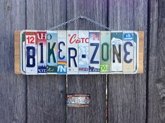 Biker Zone recycled license plate sign. Hangs on a chain on cedar wood, handmade from the woods of Idaho.
