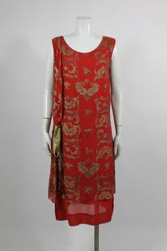 1920s Crimson Dress with Embroidered Gold Lamé Crimson red 1920s dress, accented with gold lamé sash and embroidery. The dress slips on over the head with no closures. Front 2 Private collection