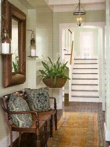 Nice arrangement with bench, mirror, wall sconces and pillows. Now, to enlarge my foyer!
