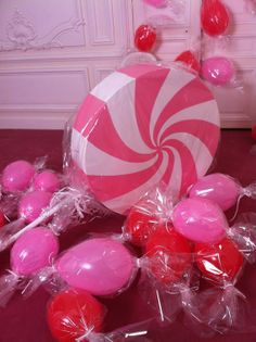 Balloons wrapped in cellophane as giant lollies.
