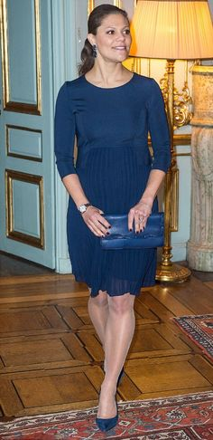 Crown Princess Victoria of Sweden showed off her growing baby bump today in an elegant midnight blue dress as she welcomed recipients of the Nobel Peace Prize to the palace in Stockholm, Sweden