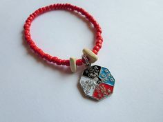 Coral Red Glass Bead & Wood Yin Yang Charmed Bracelet by Sydric, $8.00