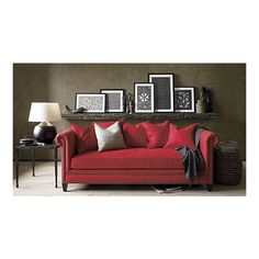 i really like the pop of the red sofa against the gray walls