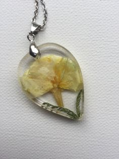Yellow Flower Rosin Necklace by ShellsArtGarden on Etsy Clear Resin, Stainless Steel Chain, Yellow Flowers, Dried Flowers, Handmade Necklaces, Necklace Lengths, Jewelry Collection, Trending Outfits, Pendant
