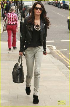 Amal Alamuddin in black leather jacket, bold necklace, slim grey jeans, black booties