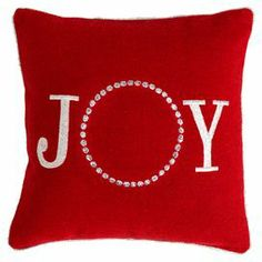 """Upcycled felt pillow in red with a text motif.    Product:  Pillow  Construction Material: Recycled felt   Color: Red   Features:    Insert included  Text motif   Dimensions:  12"""" x 12"""""""