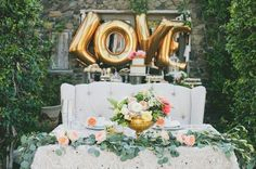 sweetheart table with gold mylar balloons and loveseat @myweddingdotcom