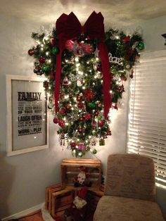I am so going to hang my tree upside down. Great Idea for a small room. i so love that big red bow!