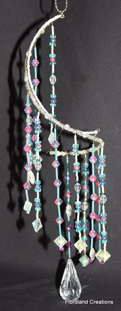 Teal & Magenta Beaded Suncatcher by FiordlandCreations on Etsy, $25.00