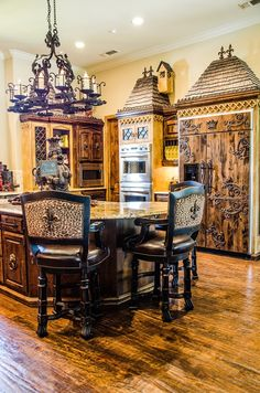 Where to begin?! The crown on the fridge; the fleur de lis on the back of leopard print stools... heaven!