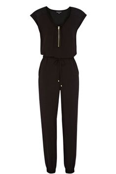 This military quilted jumpsuit is constructed out of a soft, woven fabric.This sleeveless jumpsuit is ideal for referencing the sports luxe trend, it features a v-neckline with zip detail and an elasticated band at the waist with tie fastening. The trousers are tapered with cuffed ankles and feature pockets at the reverse. Detail includes a quilted yoke. Read more at http://www.warehouse.co.uk/military%20quilted%20jumpsuit/accessories/Warehouse/fcp-product/4460002277#BYhggWKY3uUCRrAO.99