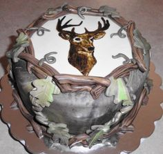 this is an all edible cake with fondant and deer hand painted on gumpaste.