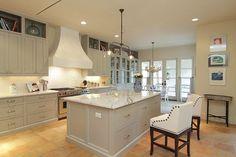 gray cabinets, saltillo tile floors, marble counters, white subway tile backsplash (cote de texas)