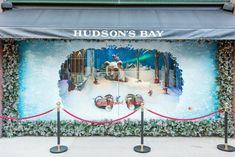 "Hudson's Bay Holiday Window Unveiling: Hudson's Bay in Toronto unveiled its holiday window display on November 3 with an event that included a performance by Mariah Carey. The theme of the window display is ""Enchanted Forest,"" offering holiday-inspired scenes showcasing hand-sculpted animals including skiing mice and a bear buried in snow."