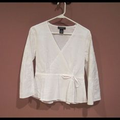 BRAND NEW - White Blouse Never worn. V-neck, tie on the left side and flounced sleeves with pretty stitched design. 100% cotton. Tops Blouses