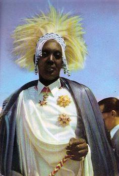Africa | Mutara Rudahigwa, King of Rwanda, awaits the arrival of King Baudouin (Belgium).  ca. 1955. || Scanned old postcard