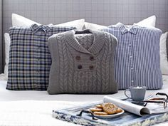 Add warm, menswear-inspired appeal to your bed pillows this winter with quick and easy slipcovers made from old sweaters and button-up shirts.