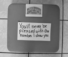 """This image is harmful because it sends the message that what ever number you see on the scale, you should be worried because it is not what you want to see. While the message may seem to mean that you shouldn't measure your weight by what a scale says, it has hidden connotative meanings. It says, """"eat less, and weigh less"""" in my mind."""