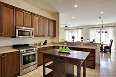 Open kitchen with medium brown cabinets and middle island, light countertops. Affordable Kitchen Cabinets, Kitchen Cupboard Doors, Refacing Kitchen Cabinets, Modern Kitchen Cabinets, Kitchen Interior, Cabinet Refacing, Home Design, Design Ideas, Kitchen Pictures