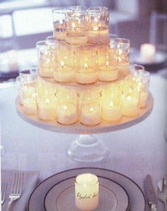 Lots of little candles and a multi-tiered cake plate for each table. Arrange the candles on each cake plate to create a stunning illusion
