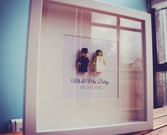Mr & mrs lego in a white frame personalised with surname and wedding date. Please leave details in note to seller.    Coloured hair can be changed