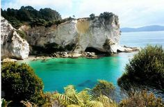 Cathedral Cove, New Zealand.  It's so beautiful that it's no wonder they filmed part of Narnia here.