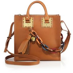 Sophie Hulme Charm-Detailed Leather Tote ($980) ❤ liked on Polyvore featuring bags, handbags, tote bags, apparel & accessories, tan, leather handbags, brown leather tote, brown purse, tan leather handbags and genuine leather handbags