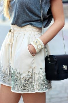 Grey tee, cream embellished shorts, statement cuff and black bag