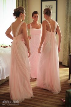 pinky/peach flowing bridesmaid dresses. I actually like this for a wedding dress, if it came in white.