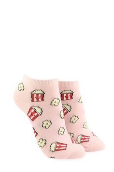 A pair of knit ankle socks with an allover pattern of smiling popcorn.