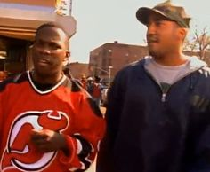 Phife Dawg wearing a custom Devils Jersey with Q-Tip in this A Tribe Called Quest video.
