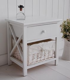 Side view of small white bedside table