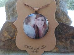 Check out this item in my Etsy shop https://www.etsy.com/listing/487089031/custom-photo-pendant-necklace-with