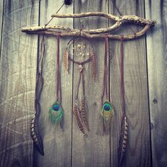 DreamCatcher - Boho Wall Hanging And Decor Feather Wind Chime With Tribal Home Decor Flair. This bohemian wall hanging has a Dreamcatcher that