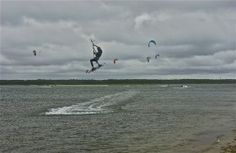 End of the road; kiteboarding; Sengekontacket; Edgartown, Martha's Vineyard, Massachusetts, USA.  August 2015.