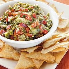 Roasted Garlic, Poblano, and Red Pepper Guacamole with Homemade Tortilla Chips | MyRecipes.com