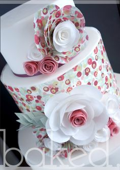 Bright pattern wedding cake with wafer paper flowers and a pop of coral and sage.