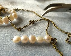 Hope you're all having a relaxing Sunday.   Here's a little work in progress pic of some new jewellery designs I'm playing around with - freshwater pearl and antique bronze. I love this colour combination