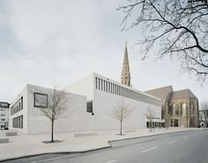Gallery of Anneliese Brost Music Forum / Bez+Kock Architekten - 1 The facade concept calls for the new brick to be refined with white plaster, enriching the dialog between the two elements.