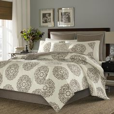 Outfit your master suite or guest room in elegant style with this cotton sateen duvet cover set, showcasing a delightful medallion motif.  ...