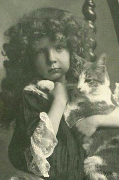 One of the first photos with a cat, 1892