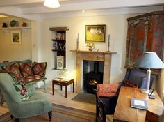 St Ives cottage rental - Living room with a sunny outlook over the garden and to the sea.