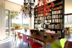 Bookshelf room divider, multicoloured dining chairs by annabelle