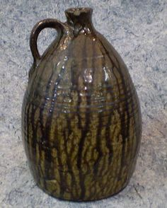 Nice form.  One of the things I like about Becham jugs is the typical beehive shape, but this semi-ovoid is really cool in comparison.  Great tobacco spit glaze.