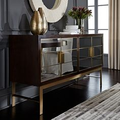 Delaney Buffet with mirrored door trimmed with brass mullions. www.mgbwhome.com